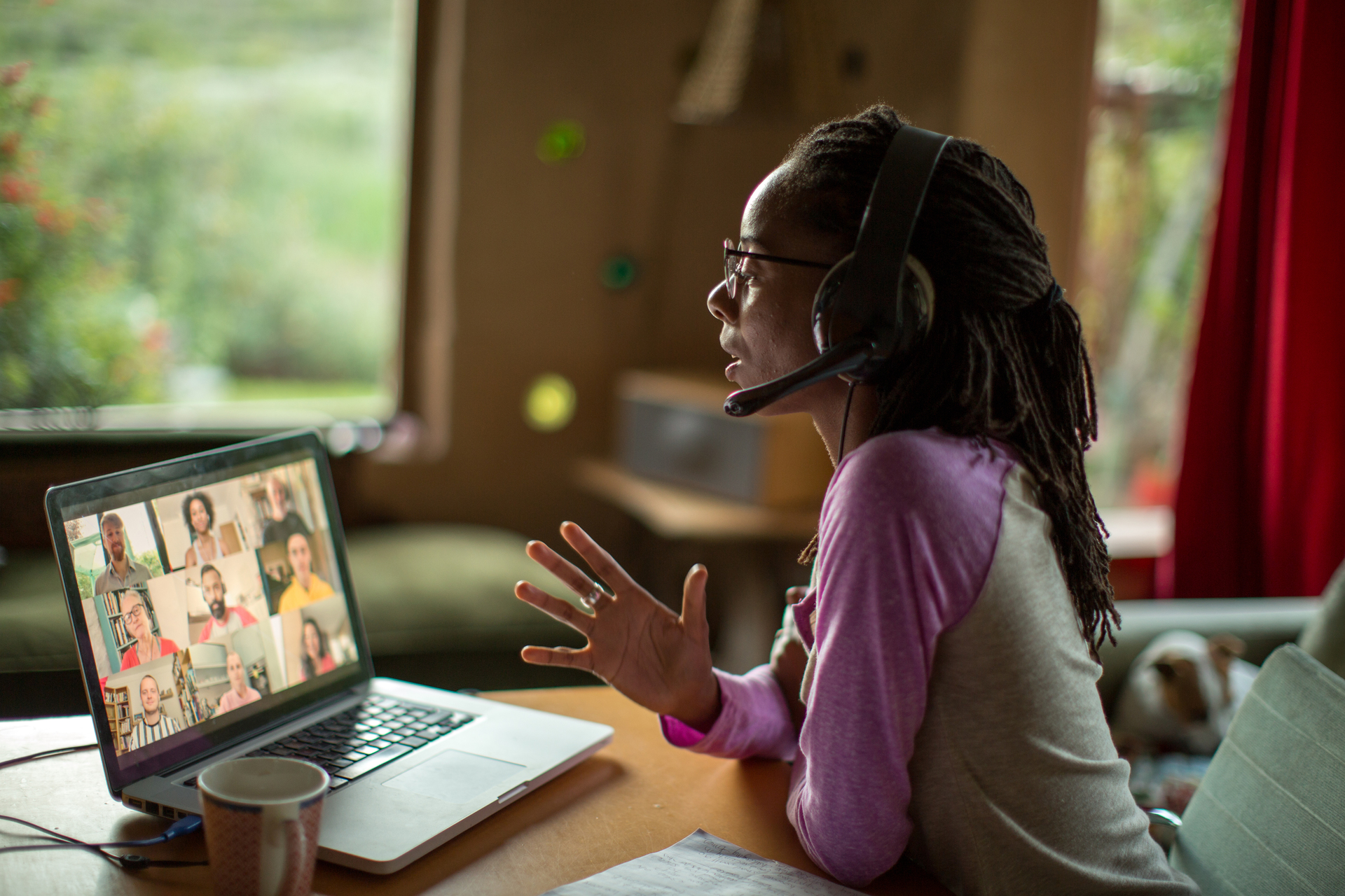 woman presenting during a virtual conference at home