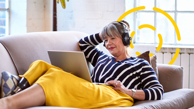 woman at home attending a virtual event on her laptop