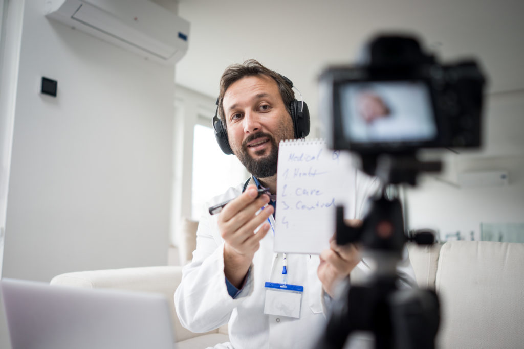 Medical expert recording video for online course