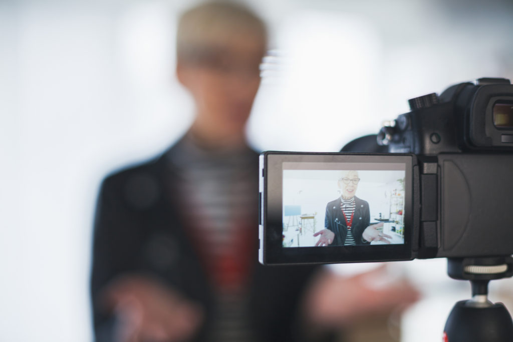 woman talking head in front of camera