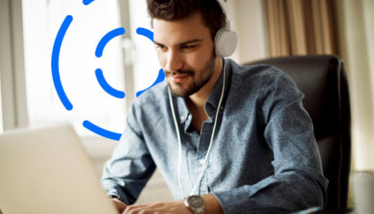 Online Video Streaming - Man on laptop with headphones.