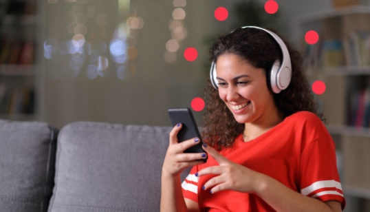 What is transcoding - woman enjoying content on her mobile device
